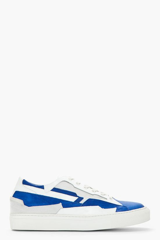 Raf Simons White And Blue Leather Low Top Space Sneakers -  Raf Simons White And Blue Leather Low Top Space Sneakers Raf Simons Low top leather sneakers in white and royal blue. Round toe. Off_white lace up closure with white eyelets. Contrast silver textile tongue and paneling throughout. Contrast white patent panel at heel collar. Textured white...