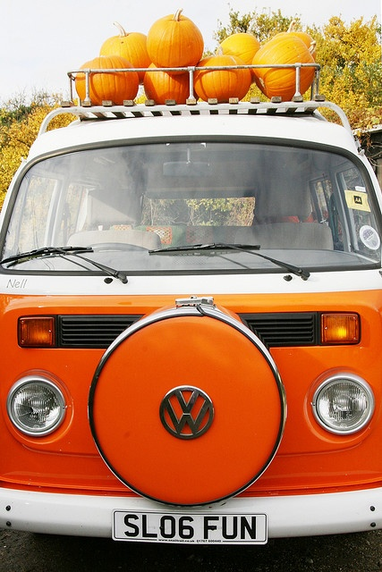 orange vw bus with pumpkins for halloween