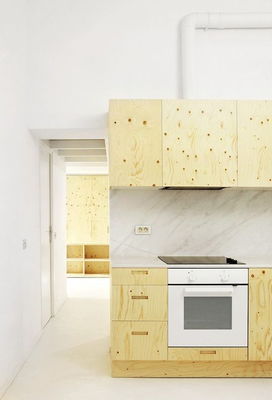Plywood kitchen.  ARQUITECTURA-G: Apartment in El Born, Barcelona