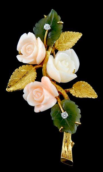 Cartier coral, jade, and diamond pin.