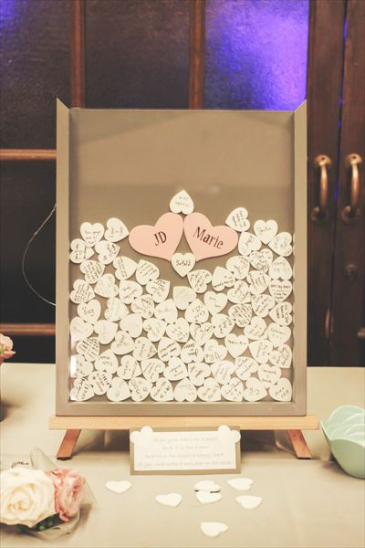 Guest Book idea: Guests sign their name on a little wooden heart and drop it in a shadow box frame. Such a good idea and would look adorable on display in your home!