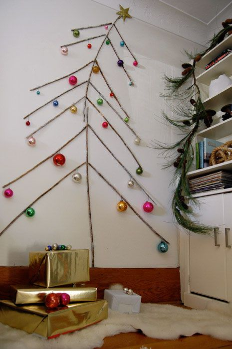 this wall christmas tree made from twigs reminds me of the charlie brown tree