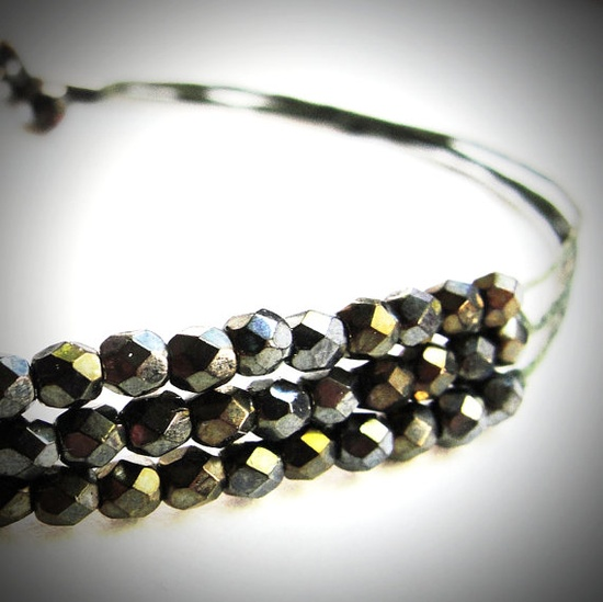 Verde glass beaded bracelet on green linen...yum.  $22 from JewelryByMaeBee on Etsy.