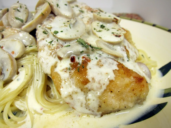 Carrabba's Champagne Chicken  2  Tbsp olive oil  2 Tbsp butter  4 chicken cutlets  1/3 cup flour  2 Tbsp parmesan cheese  salt  pepper  1/2 cup sliced mushrooms   1/4 cup champagne (Dry)  2/3 cup heavy cream   pinch Kosher Salt  pinch Fresh Ground Black Pepper   1/8 tsp red peper flakes  1/4 tsp tarragon  6 oz angel hair pasta, cooked and drained