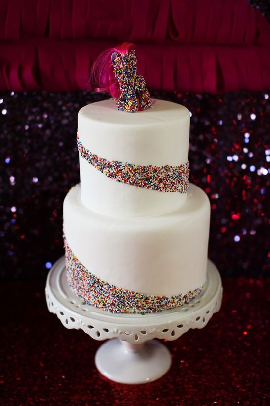 sprinkles wedding cake... Not too sure what that thing on top is though