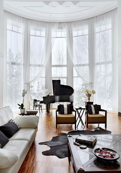 What could be more glamorous than a piano, floor to ceiling windows, and artfully draped curtains?   Luxurious House Design by Russian Architects, Black and White