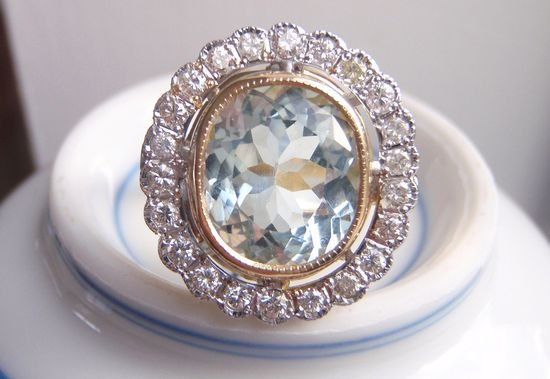 Something blue. Aquamarine and 22 Brilliant Cut Genuine Diamonds. $3,400.00.