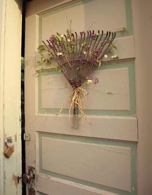 Use an old rake as a wreath