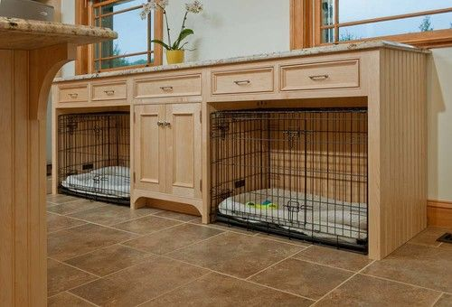 Kennels in laundry room.