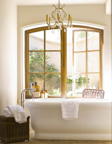 Design Chic - gorgeous windows in the bathroom and love the chandelier