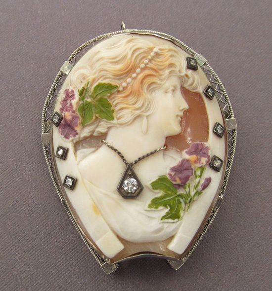 Circa 1900 Lady Shell Cameo Brooch 14 Karat Gold Horse Shoe with Diamonds and Enamel Flowers.