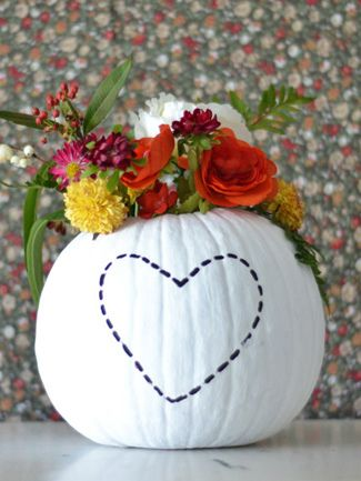 All you need is white paint and some creativity for this sleek DIY pumpkin flower vase