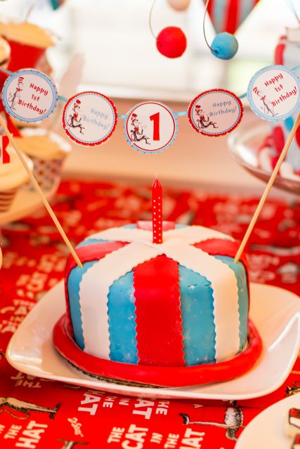 Cute smash cake at a Dr. Seuss party!  See more party ideas at CatchMyParty.com!  #drseuss #partyideas