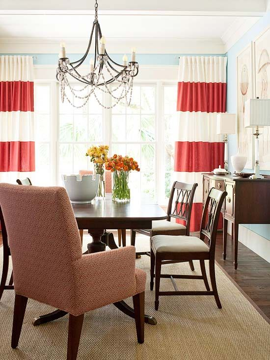 coral/white striped curtains against blue walls