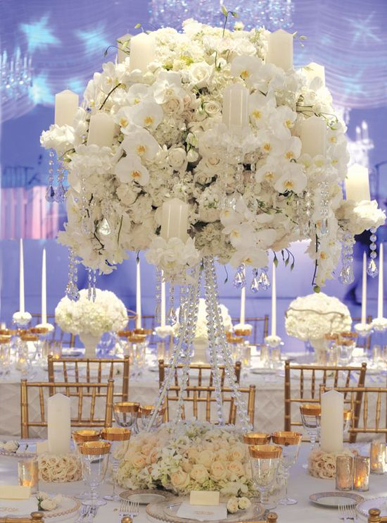 Gorgeous centerpiece with lilies of the valley, hydrangeas, orchids, ranunculus, roses and gardenias.