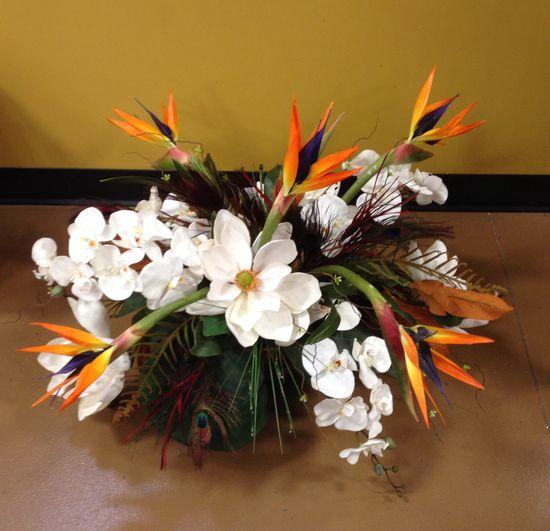 Magnolia and bird of paradise arrangement