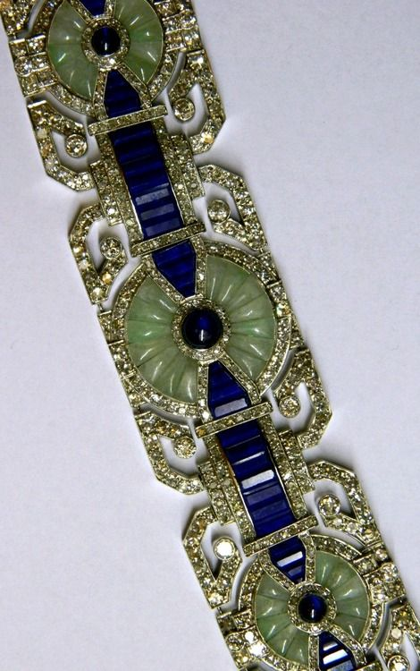 Art Deco Bracelet by Fouquet, circa 1925.  -  an unusual combination of precious stones including old cut diamonds, sapphires, jade and lapis lazuli on the classic platinum mounting of the time.