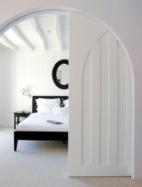 beautiful arched pocket door