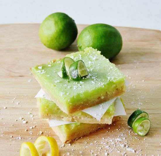 Citrus tangy goodness ... Lemon Lime Bars  Visit: www.thistlewoodfa... for the recipe! Food photography Sweet treats #foodphotography spring treats #springtreats #sweettreats #lemonbars  #lemon #lime #dessert #recipe