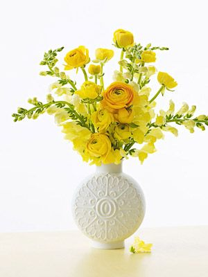 """Here's how: After cutting stems, place ranunculus in a narrow-necked vase. Leave snapdragon stalks a bit longer and add into the arrangement to give height. """"Don't force the flowers into a shape,"""" says White. """"Let them go their own whimsical way."""""""