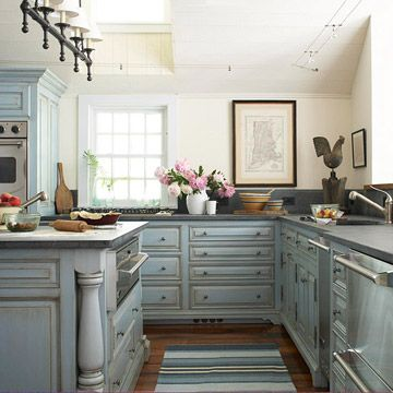 Kitchen with antique-finish blue cabinets