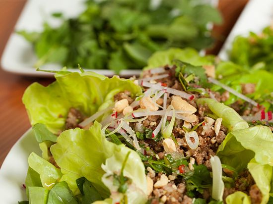 Thai-Pork Salad with Fresh Herbs by tastingtable: Sweet, spicy, pungent and sour. Enjoy it salad style or as a lettuce wrap.  #Salad #Pork #Thai