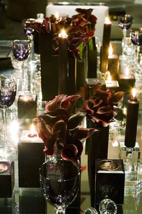 Black rectangular vases become even more dramatic when topped with dark burgundy Calla lilies.