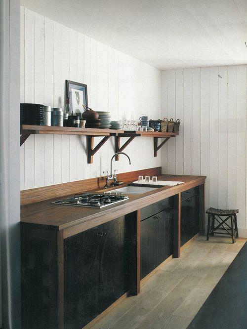 Simple wooden shelves above kitchen countertop