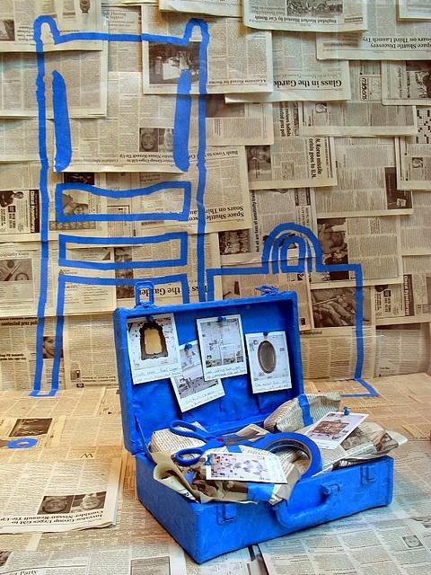 ? Retail store window display visual merchandising Newspaper blue
