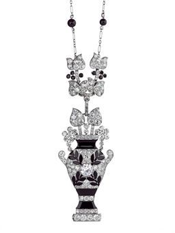AN EXQUISITE ART DECO ONYX AND DIAMOND NECKLACE, BY CARTIER
