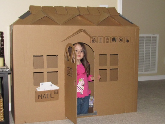 House I made for the kids out of a cardboard box (TV).  Used the window cutouts for the shingles, and all the extra corners for the dormers.  So Cute, they are having a ball with it!