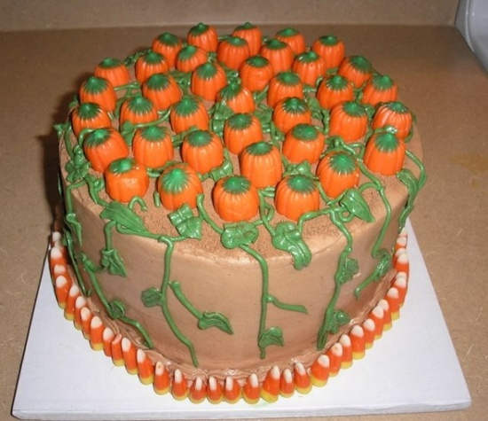 Pumpkin cake: candy corn around the base, and candy pumkins on top.