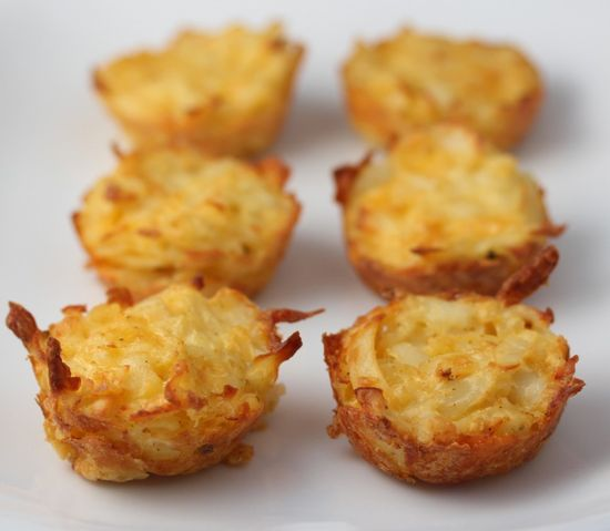 Potato bites - Mix Grated potatoes, 3 eggs, 1/2 cup shredded cheddar cheese, 1/4 finely chopped onion (optional), 1/4 teaspoon garlic powder, salt and pepper to taste in a bowl and spoon into a muffin tray, bake for about 20 minutes.