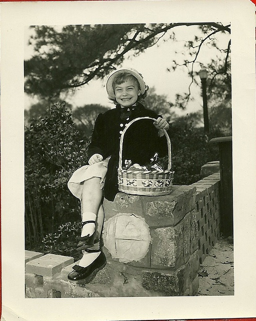 Now that is one happy Easter camper, if ever there was! :) #kids #dress #basket #eggs #candy #hat #bonnet #children #girl #vintage #retro #Easter #kitsch #1950s #fifties #50s