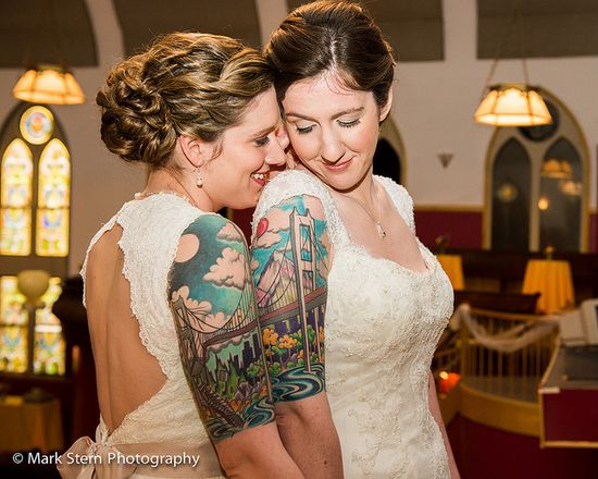 DYING over the brides' shared/connected bridge tattoos!