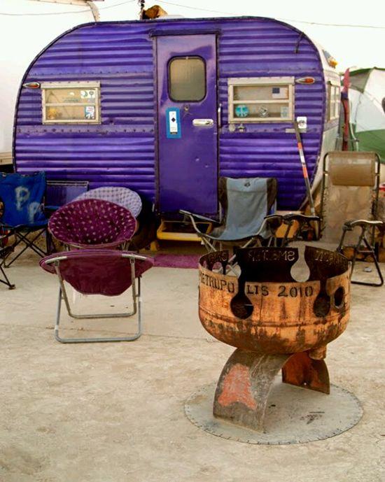 Purple travel trailer.