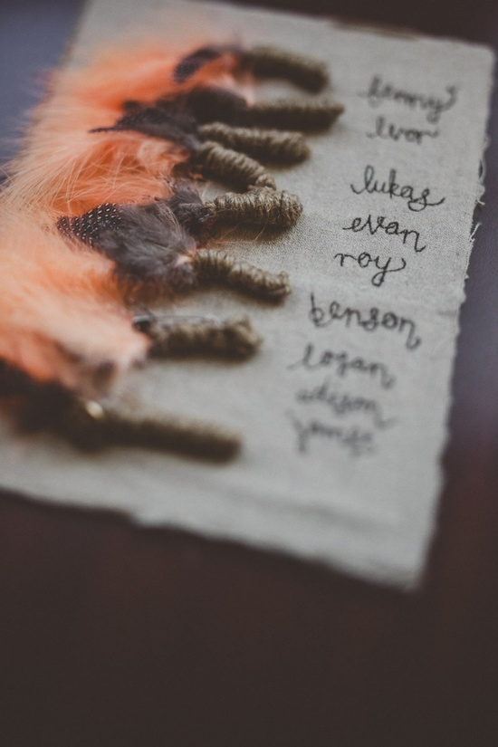 orange feather boutonnieres.