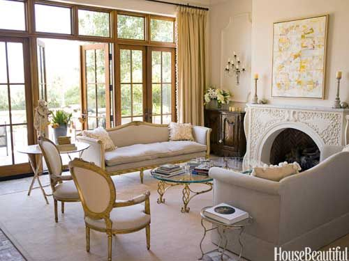 A new sofa was made to match the graceful lines of its Louis XV counterpart. Design: Dana Lyon. housebeautiful.com.