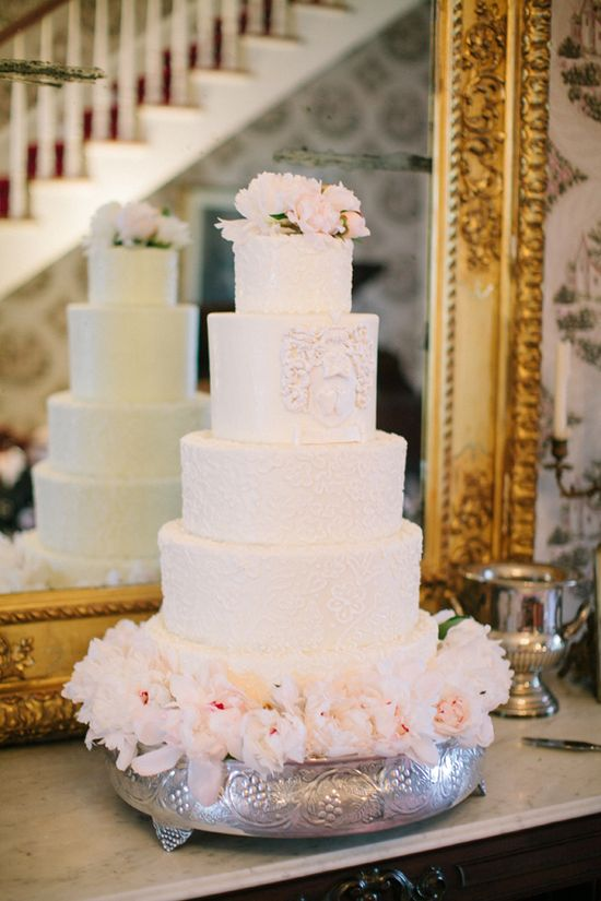 Romantic wedding cake with lovely patterned details