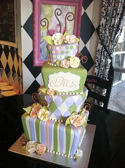 Green purple topsy turvy wedding by Designer Cakes By April, via Flickr
