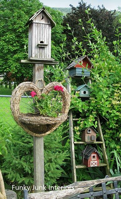 Bird houses on ladder in tall foliage