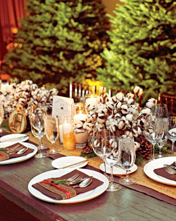Winter centerpieces of cotton bolls, pine cones, evergreen sprigs, and flickering candles
