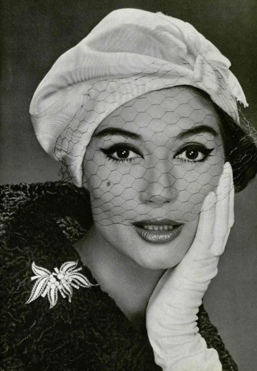Simone D'Aillencourt in a hat by Lanvin-Castillo and brooch by Mauboussin, 1958. Photo: Philippe Pottier.