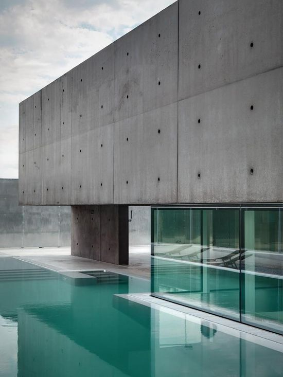 Italian modernist concrete and glass house by Matteo Casari Architetti obstructs the view from the outside for interior privacy:  Click to see the project and Follow Matteo Casari Architetti in your stream: www.archello.com/... #Architecture #Design