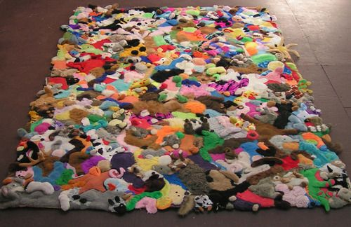 A rug assembled from stuffed animals   (minus the stuffing it would appear?) - this would be a great keepsake rather than throwing the toys away.   For those stored bins of TY beanies perhaps?  lol
