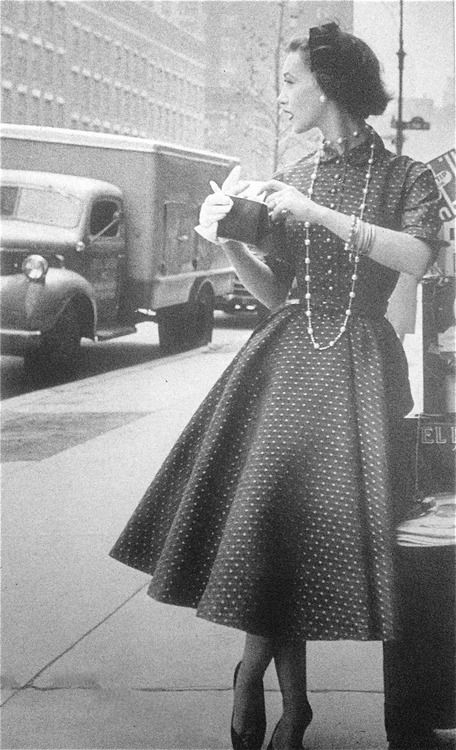 A charming full skirted dress worn with a long necklace, 1954. #vintage #1950s #fashion #dress