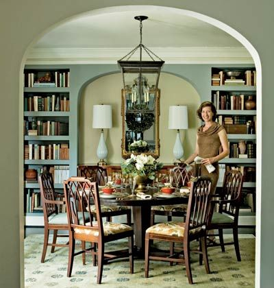 Dining with books. Love this room...the colors and furniture.