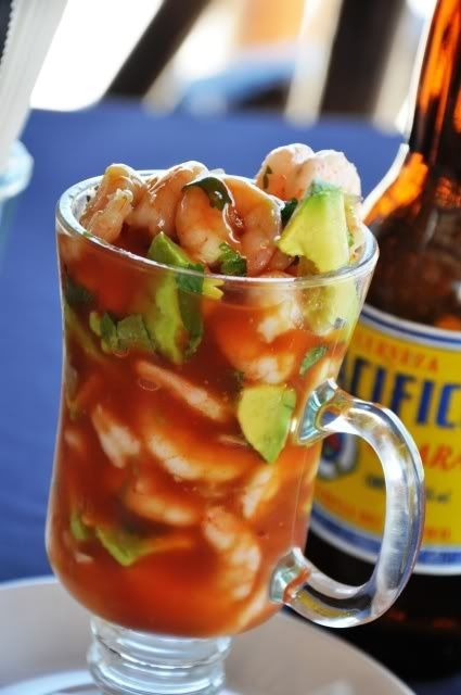 Coctel De Camarones (Mexican shrimp cocktail) - 1 -2 lb shelled and cooked shrimp (50-60 count), 2 -3 large tomatoes , chopped 1/2 small white onions, chopped or 2 green onions, 1/2 cup cilantro , slightly chopped 1/2 jalapeno , diced, with seeds, 1 avocado , chopped, tomato juice (V8), lime juice, salt and pepper Mix all in glass bowl and chill, serve with crackers.