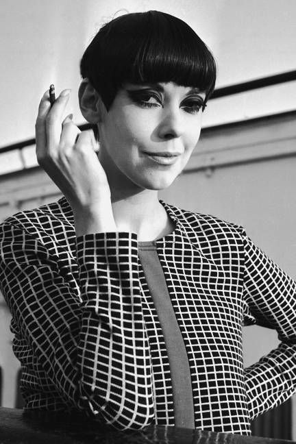 """Peggy Moffitt, 1965 A bowl cut for women? Why, yes: Vidal Sassoon clipped the iconic '60s model's thick black hair—fringe and all—creating what later would be known to hairdressers far and wide as the """"five-point"""" cut. With a higher middle and lower sides, this face-framing fringe is still favored by Moffitt at age 73!"""