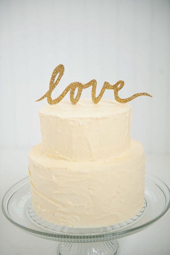 Gold glitter LOVE script wedding cake topper via Etsy